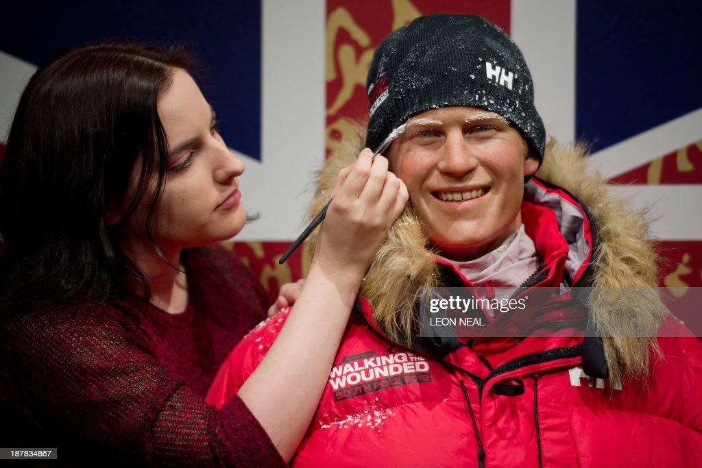 Madame Tussauds artist Luisa Compobassi poses with a wax figure of <a gi-track='captionPersonalityLinkClicked' href=/galleries/search?phrase=Prince+Harry&family=editorial&specificpeople=178173 ng-click='$event.stopPropagation()'>Prince Harry</a>, dressed in polar clothing, at Madame Tussauds in central London on November 13, 2013. The costume change is to pay tribute to <a gi-track='captionPersonalityLinkClicked' href=/galleries/search?phrase=Prince+Harry&family=editorial&specificpeople=178173 ng-click='$event.stopPropagation()'>Prince Harry</a>'s participation in the 208 mile 'Walking with the Wounded' South Pole Allied Challenge. PHOTO / LEON NEAL