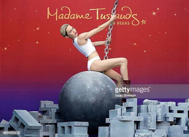 Madame Tussauds debuts their Miley Cyrus wax figure atop a wrecking ball at The Venetian Las Vegas on March 9 2015 in Las Vegas Nevada