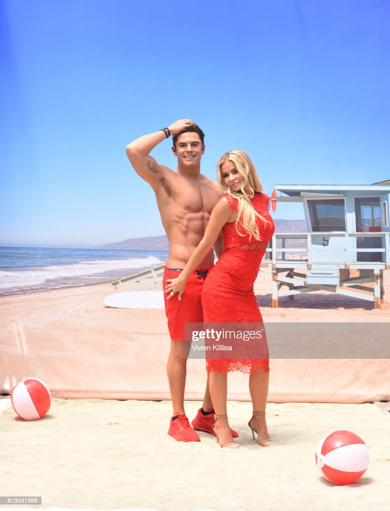 "Madame Tussauds Hollywood unveils new Zac Efron ""Baywatch"" wax figure with Carmen Electra and the men from Australia's Thunder from Down Under"