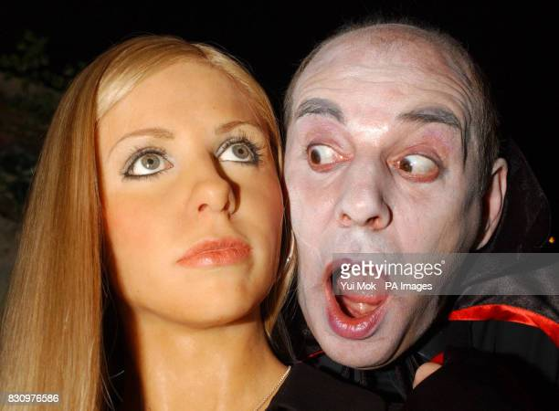 Madame Tussaud's host Andy Aliffe dressed up as a vampire is despatched by a new waxwork model of Buffy The Vampire Slayer on display at Madame...