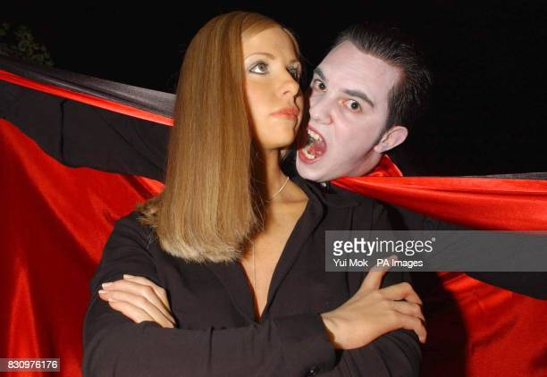 Madame Tussaud's host Keith Shaw dresses up as a vampire to attack a new waxwork model of Buffy The Vampire Slayer on display at Madame Tussaud's in...