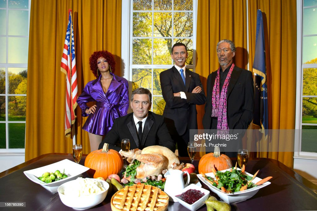 Madame Tussauds London marks US President Barrack Obama's fourth Thanksgiving in office with a grouping of his waxwork figures alongside waxworks of <a gi-track='captionPersonalityLinkClicked' href=/galleries/search?phrase=Rihanna&family=editorial&specificpeople=453439 ng-click='$event.stopPropagation()'>Rihanna</a>, <a gi-track='captionPersonalityLinkClicked' href=/galleries/search?phrase=George+Clooney&family=editorial&specificpeople=202529 ng-click='$event.stopPropagation()'>George Clooney</a> and <a gi-track='captionPersonalityLinkClicked' href=/galleries/search?phrase=Morgan+Freeman&family=editorial&specificpeople=169833 ng-click='$event.stopPropagation()'>Morgan Freeman</a> for an early Thanksgiving celebration in the Oval Office set on November 21, 2012 in London, England.