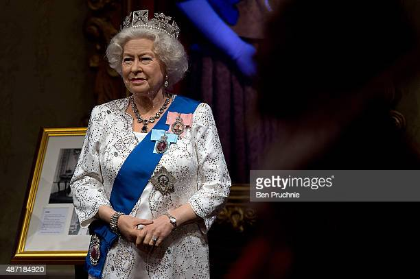 Madame Tussauds refreshes its Queen Elizabeth II wax figure with a recreation of the longest reigning monarch's diamond jubilee dress at Madame...