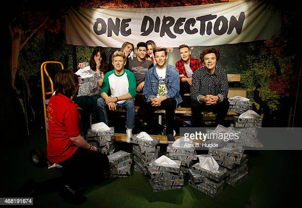 Madame Tussauds tissue attendant hands One Direction fan Tansay RatcliffeJames a tissue following the news of the departure of Zayn Malik from One...