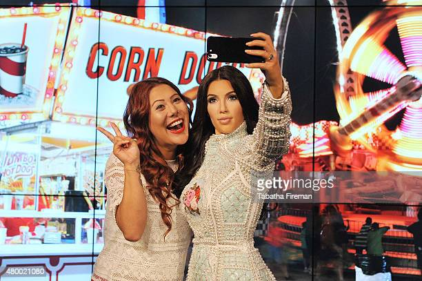 Madame Tussauds unveil a new wax figure of Kim Kardashian which takes selfies against changing location backdrops Fan Helen Smith poses for a selfie...