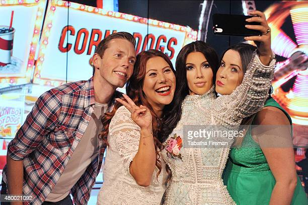 Madame Tussauds unveil a new wax figure of Kim Kardashian which takes selfies against changing location backdrops Fans Alex Cameron Helen Smith and...