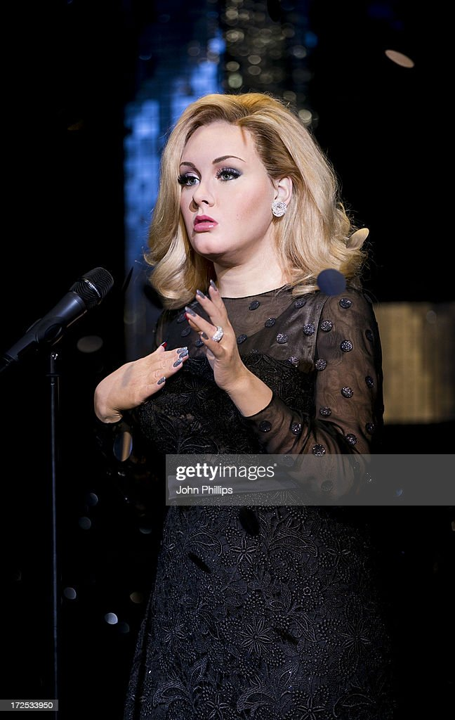 Madame Tussauds unveil a new waxwork of Adele at Madame Tussauds on July 3, 2013 in London, England.
