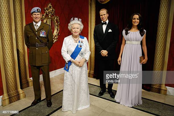Madame Tussauds wax figures of Prince Harry Queen Elizabeth II Prince William Duke of Cambridge and Catherine Duchess of Cambridge on display as wax...