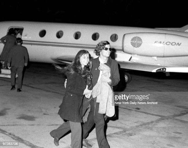 Madcap millionaire Michael James Brody Jr busses his wife Renee at Westchester County Airport after flight from Puerto Rico Then the margarine heir...