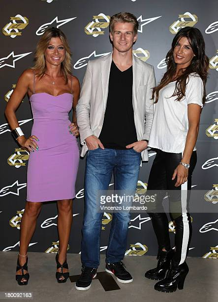 Maddalena Corvaglia Nico Hulkenberg and Elisabetta Canalis attend the Alpinestars 50th Anniversary Event at Progetto Calabiana on September 8 2013 in...