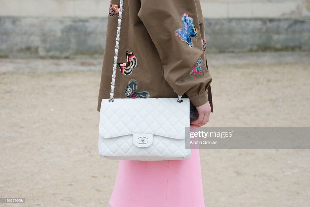 Maddelina Pizzonia wears a Valentino jacket Cos skirt and Chanel bag on day 8 of Paris Collections Women on March 10 2015 in Paris France