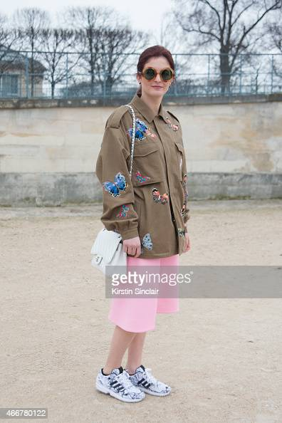 Maddelina Pizzonia wears a Valentino jacket Cos skirt Chanel bag vintage sunglasses and Adidas trainers on day 8 of Paris Collections Women on March...