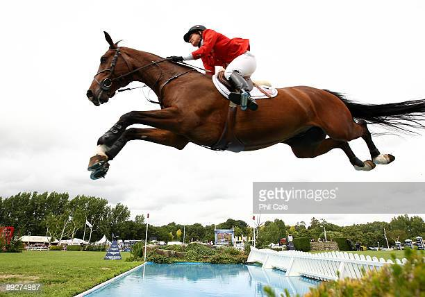 Madden Beezie riding of the United States clears the water jump during the Longines King George V Gold Cup at the Longines International Horse Show...