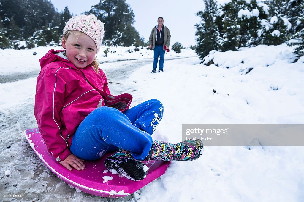 Maddie Behrens (6yrs) enjoys the winter snowfall with her mum, Erika Behrens on June 25, 2016 in Cradle Mountain, Australia. Snow has been forecast across Eastern Australia as cold front continues to bring low temperatures, rain and potentially damaging winds.