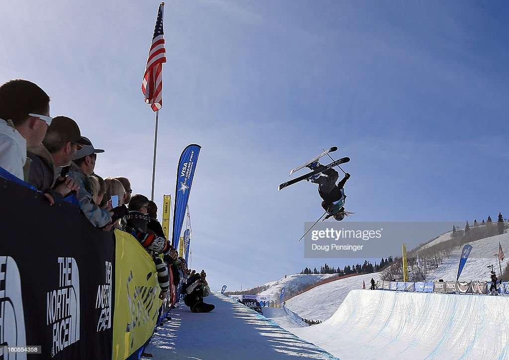 Maddie Bowman of the USA spins above the pipe as the spectators witness Bowman winning the ladies FIS Freestyle Ski Halfpipe World Cup during the Sprint U.S. Grand Prix at Park City Mountain on February 2, 2013 in Park City, Utah.