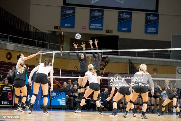 Maddie Fischer of Wittenberg University taps the ball over the net past Shelbi Stein and Melanie Moore of ClaremontMuddScripps during the Division...