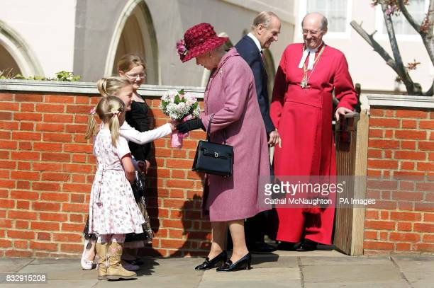 Maddie Gainer and Natasha Gainer watch as Abigail Gainer presents HRH Queen Elizabeth II a bouquet of flowers as the Queen and the Duke of Edinburgh...