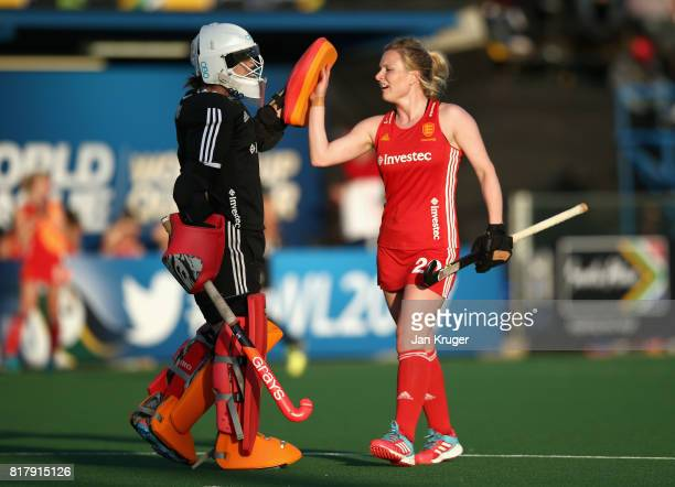 Maddie Hinch of England and Hollie Webb of England celebrate their sides third goal during the Quarter Final match between England and India during...