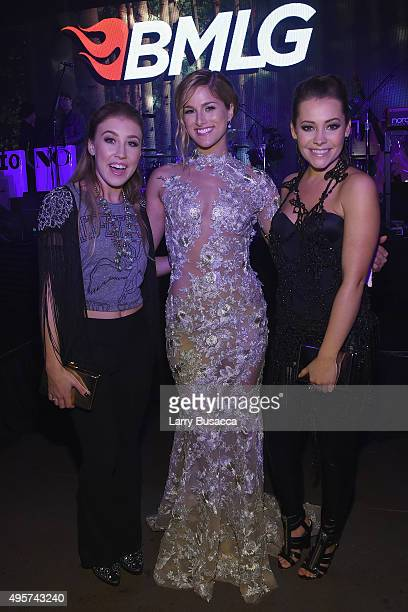 Maddie Marlow and Tae Dye of musical duo Maddie Tae pose with Singer Cassadee Pope as Big Machine Label Group celebrates The 49th Annual CMA Awards...