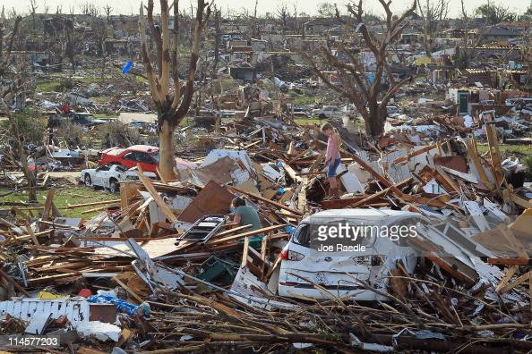 Maddie Meek and her mother Dina Meek salvage what they can from her sisterinlaw's home after it was destroyed when massive tornado passed through the...