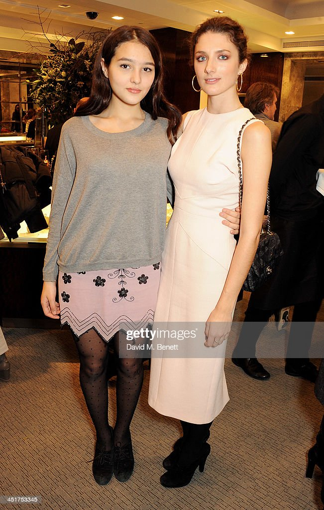 Maddie Mills (L) and Daisy Bevan attend as Joely Richardson officially opens the Tiffany & Co. Christmas Shop on Bond Street, London on November 24, 2013 in London, England.