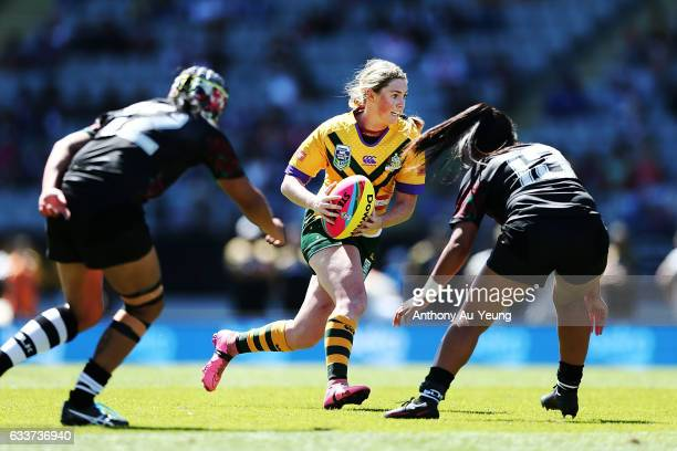 Maddie Studdon of the Australian makes a run during the 2017 Auckland Nines match between the Kiwi Ferns and the Australian Jillaroos at Eden Park on...