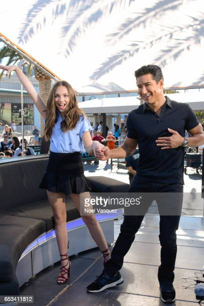 Maddie Ziegler and Mario Lopez visit 'Extra' at Universal Studios Hollywood on March 14 2017 in Universal City California