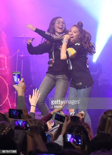 Maddie Ziegler celebrates on stage with Johnny Orlando Mackenzie Ziegler during their 'Day NIght' tour at Mr Smalls on October 28 2017 in Millvale...