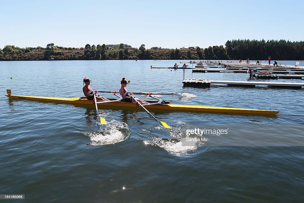 Maddison Hocking (L) and Alice Pallister of Howick College girls U18 novice double leave the start pontoon in the D final during day four of the Maadi Cup at Lake Karapiro on March 21, 2013 in Cambridge, New Zealand.