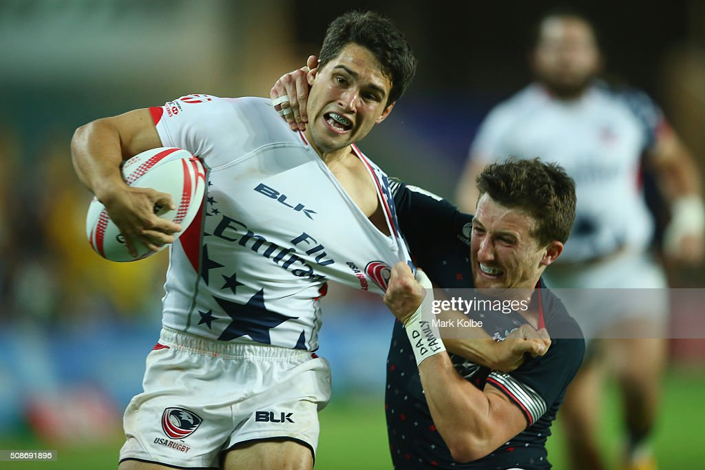 Maddison Hughes of the United States of America is tackled by Alex Davis of England during them match between England and the USA at the 2016 Sydney Sevens at Allianz Stadium on February 6, 2016 in Sydney, Australia.