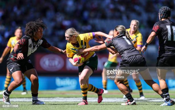 Maddison Studdon of the Jillaroos looks to beat the tackle of Teuila FotuMoala of the Black Ferns during the 2017 Auckland Nines match between the...
