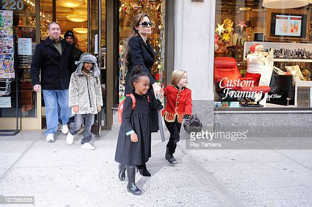 Maddox JoliePitt actress Angelina Jolie Zahara JoliePitt and Shiloh JoliePitt leave Lee's Art Shop on December 7 2010 in New York City