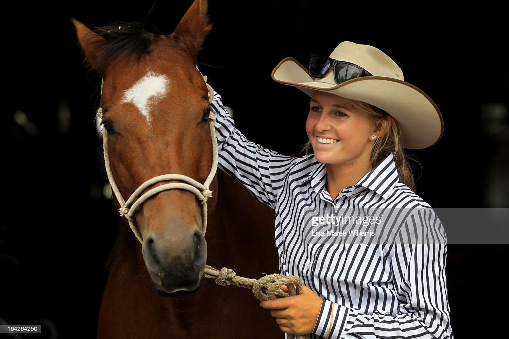 Maddy Coleman poses with show horse 'Chopper' at the Sydney Royal Easter Show on March 22, 2013 in Sydney, Australia. Organisers are expecting over 900,000 visitors to the annual agricultural event, the largest of its kind in Australia. The Easter Show marks its 190th show since opening in Paramatta in 1823.