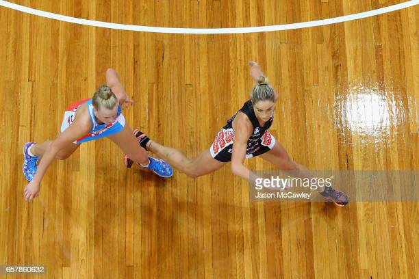 Maddy Turner of the Swifts and Cody Lange of the Magpies in action during the round six Super Netball match between the Swifts and the Magpies at...