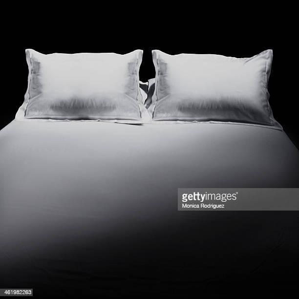 Made bed with two pillows