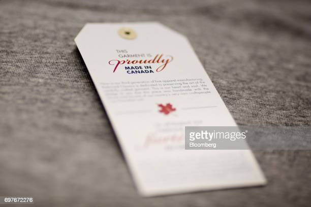 A 'Made In Canada' clothing tag is seen at the WS Co production facility in Toronto Ontario Canada on Friday June 9 2017 Canada Day celebrates the...