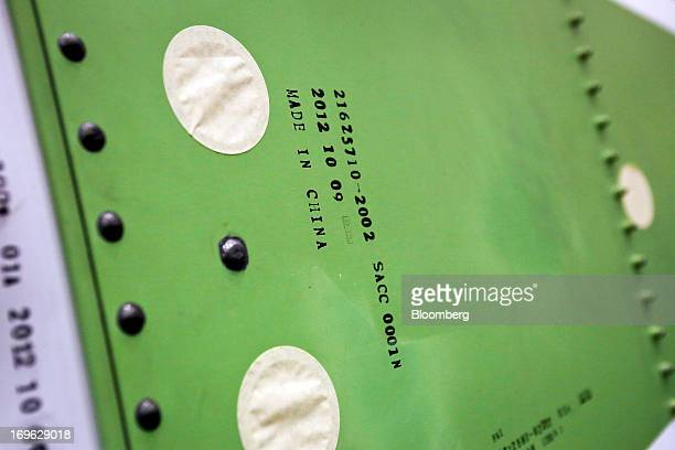 A Made In China stamp is displayed on a Boeing Co 787 Dreamliner vertical stabilizer made of composite materials and an outer aluminum skin before...