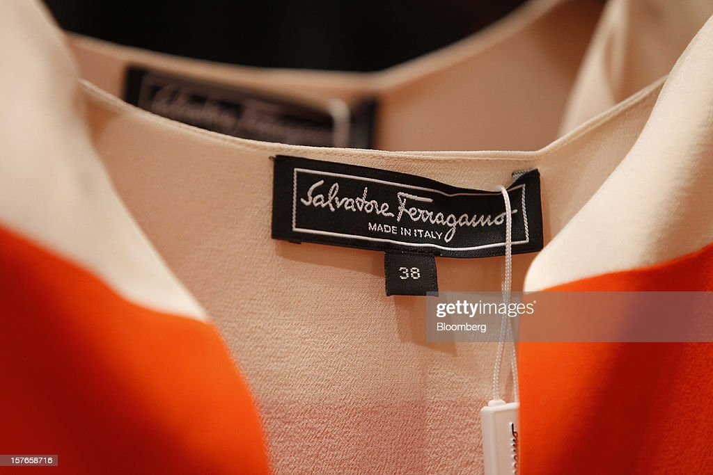 A 'Made in Italy' logo sits on a label in a lady's garment inside Salvatore Ferragamo SpA's Sloane Street store in London, U.K., on Wednesday, Dec. 5, 2012. Demand for Ferragamo's shoes and other items is increasing even as China's economy slows and Europe's debt crisis weighs on consumer spending. Photographer: Simon Dawson/Bloomberg via Getty Images