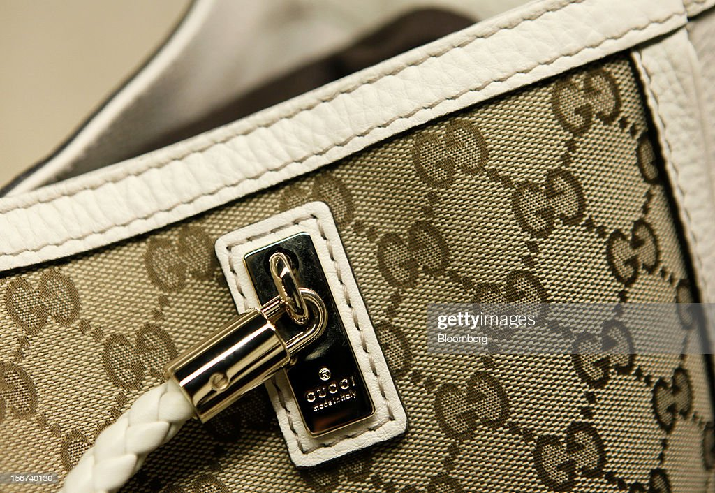 A 'made in italy' symbol sits beneath the Gucci logo of a 'Diana' bag inside a Gucci store, a luxury unit of France's PPR SA, in Rome, Italy, on Monday, Nov. 19, 2012. PPR SA, the French owner of the Gucci and Puma brands, said it's confident of revenue and profit growth in 2012. Photographer: Alessia Pierdomenico/Bloomberg via Getty Images
