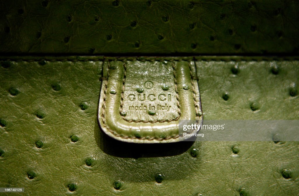 A 'made in italy' symbol sits beneath the Gucci logo of a 'Soho' bag displayed for sale inside a Gucci store, a luxury unit of France's PPR SA, in Rome, Italy, on Monday, Nov. 19, 2012. PPR SA, the French owner of the Gucci and Puma brands, said it's confident of revenue and profit growth in 2012. Photographer: Alessia Pierdomenico/Bloomberg via Getty Images