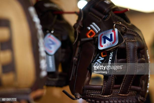 A 'Made In The USA' tag is displayed on a Nokona baseball glove on display for sale inside the store at the company's manufacturing facility in...