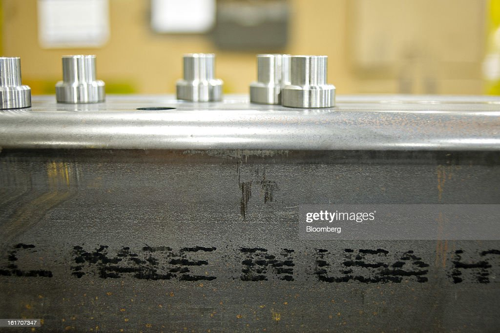 'Made in USA' appears stamped on an axel component for an agricultural sprayer during production at the Giese Manufacturing Co. in Dubuque, Iowa, U.S., on Thursday, Feb. 14, 2013. The U.S. Federal Reserve is schedule to release industrial productions figures on Feb. 15. Photographer: Daniel Acker/Bloomberg via Getty Images