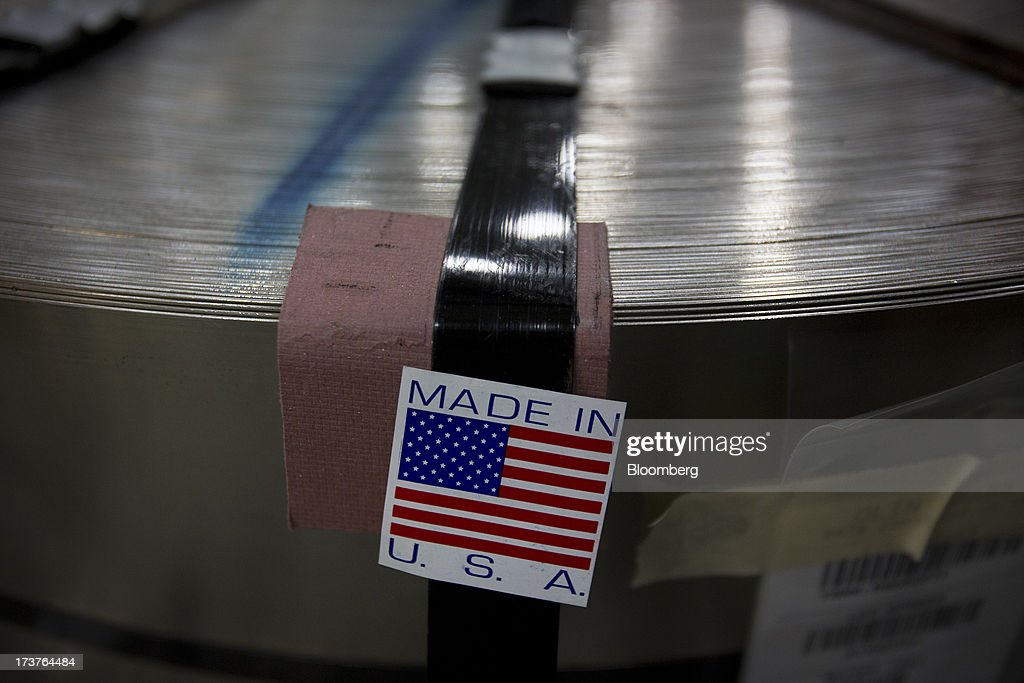 A 'Made in U.S.A.' sticker is placed on a coil of metal which will be used to stamp nickels at the U.S. Mint in Philadelphia, Pennsylvania, U.S., on Wednesday, July 17, 2013. Some sources of declining inflation 'are likely to be transitory' and expectations for future price increases 'have generally remained stable,' Ben S. Bernanke, chairman of the U.S. Federal Reserve said in prepared remarks. Photographer: Scott Eells/Bloomberg via Getty Images