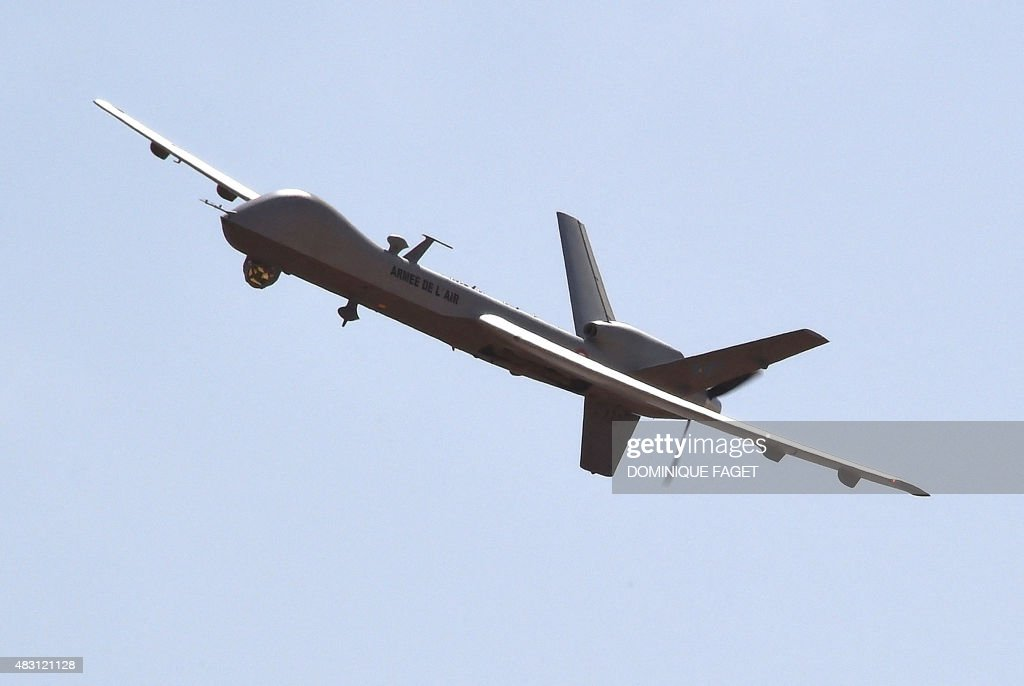 A US made Reaper drone part of Operation Barkhane's aerial detachment flies over the Nigerian military airport Diori Hamani in Niamey on January 2...