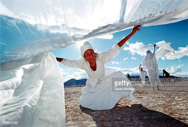 Madelaina Bolouc of Boulder CO performs a dance of reverence to Orisha and Obatala in gratitude for blue sky and luminous clouds September 2 2000 at...