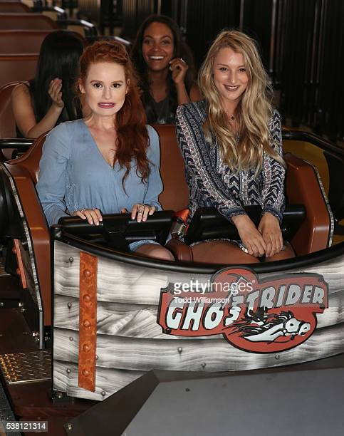 Madelaine Petsch and friend ride a rollarcoaster at the GHOSTRIDER Reopening @ Knott's Berry Farm Buena Park CA at Knott's Berry Farm on June 4 2016...