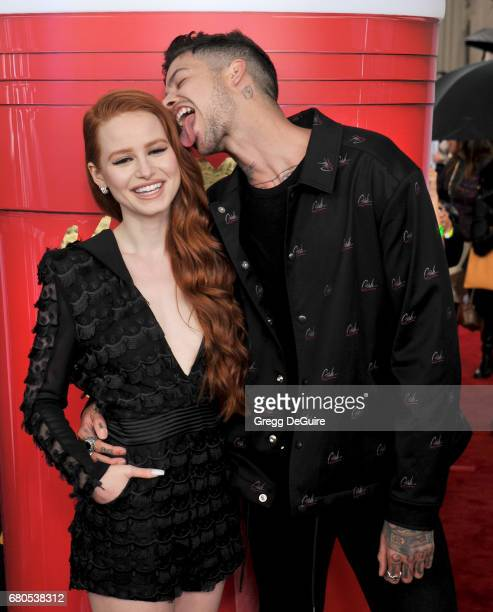 Madelaine Petsch and Travis Mills arrive at the 2017 MTV Movie And TV Awards at The Shrine Auditorium on May 7 2017 in Los Angeles California