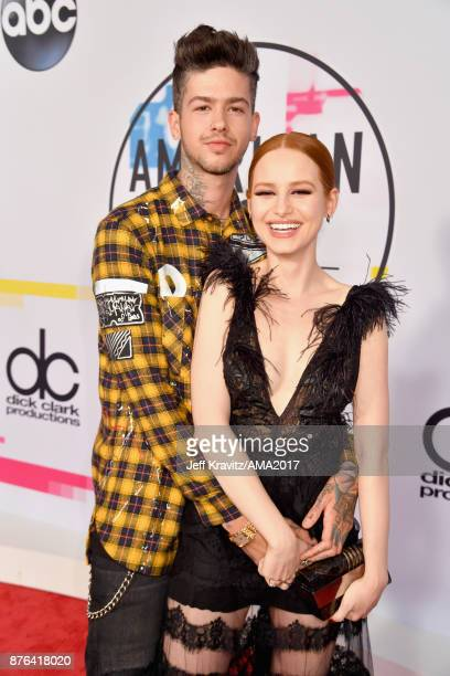 Madelaine Petsch and Travis Mills attend the 2017 American Music Awards at Microsoft Theater on November 19 2017 in Los Angeles California