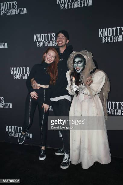 Madelaine Petsch and Travis Mills attend the Knott's Scary Farm and Instagram's Celebrity Night at Knott's Berry Farm on September 29 2017 in Buena...