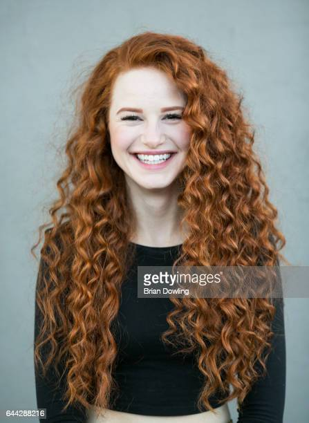 Madelaine Petsch poses for portraits for the book 'Redhead Beauty' by Brian Dowling on Melrose Place on November 26 2014 in West Hollywood California